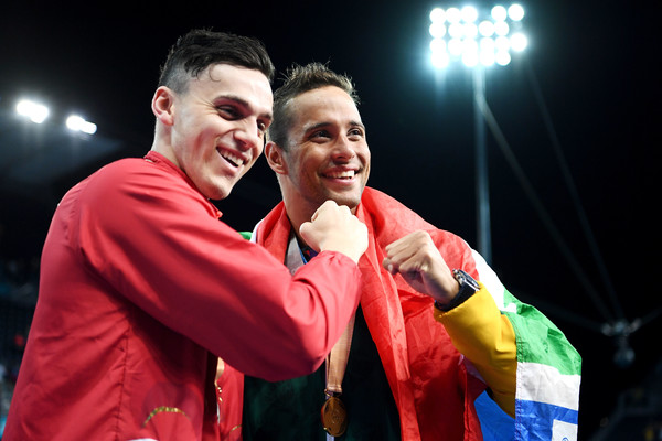 Swimming - Commonwealth Games Day 5 [event,performance,fun,gesture,performing arts,heater,stage,games,james guy,chad le clos,l-r,england,south africa,optus aquatic centre,gold coast,commonwealth games,medal ceremony,mens 100m butterfly final]