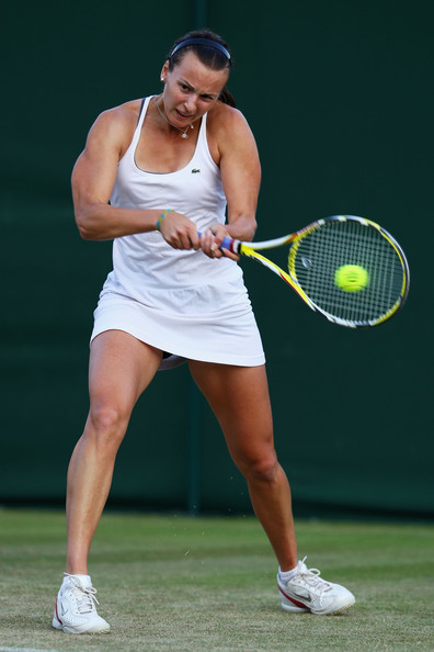 Yaroslava Shvedova Yaroslava Shvedova of Kazakhstan plays a backhand during the women's singles second round match against Melanie Oudin of USA on Day Four of the Wimbledon Lawn Tennis Championships at the All England Lawn Tennis and Croquet Club on June 25, 2009 in London, England.