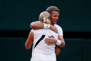 Mark Knowles of Bahamas and Anna-Lena Groenefeld of Germany celebrate victory during the mixed doubles final match against Leander Paes of India plays a forehand playing with Cara Black of Zimbabwe on Day Thirteen of the Wimbledon Lawn Tennis Championships at the All England Lawn Tennis and Croquet Club on July 5, 2009 in London, England.