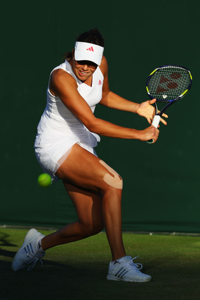 Ana Ivanovic of Serbia plays a backhand during the women's singles first round match against Lucie Hradecka of Czech Republic on Day Two of the Wimbledon Lawn Tennis Championships at the All England Lawn Tennis and Croquet Club on June 23, 2009 in London, England.