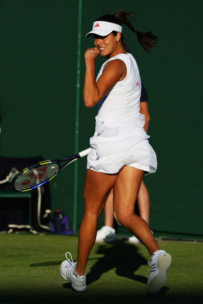 Ana Ivanovic of Serbia celebrates during the women's singles first round match against Lucie Hradecka of Czech Republic on Day Two of the Wimbledon Lawn Tennis Championships at the All England Lawn Tennis and Croquet Club on June 23, 2009 in London, England.