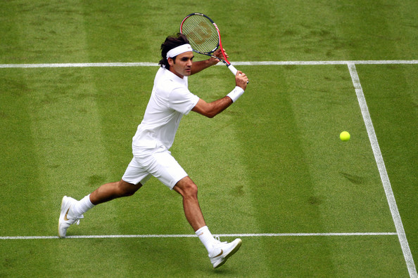 Roger Federer of Switzerland in action during his first round match against Alejandro Falla of Columbiaon Day One of the Wimbledon Lawn Tennis Championships at the All England Lawn Tennis and Croquet Club on June 21, 2010 in London, England.