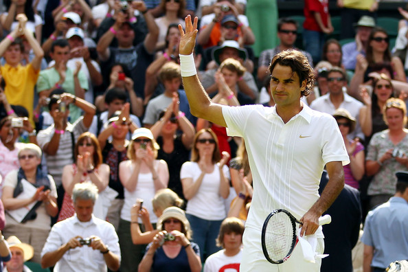 Roger Federer of Switzerland celebrates winning his first round match against Alejandro Falla of Columbiaon Day One of the Wimbledon Lawn Tennis Championships at the All England Lawn Tennis and Croquet Club on June 21, 2010 in London, England.