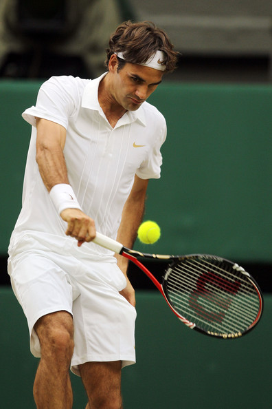 Roger Federer of Switzerland in action during his match against Arnaud Clement of France on Day Five of the Wimbledon Lawn Tennis Championships at the All England Lawn Tennis and Croquet Club on June 25, 2010 in London, England.
