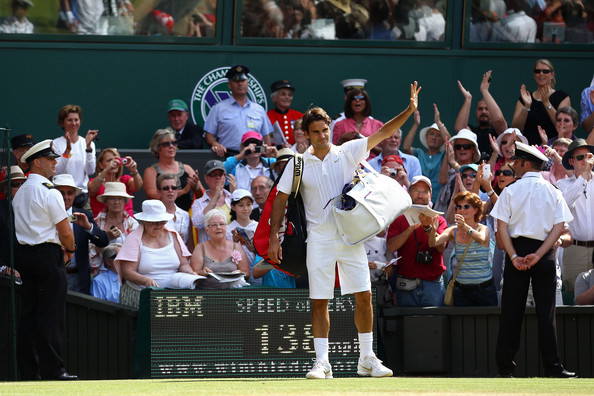 Roger Federer of Switzerland waves as he exits after losing his Quarter Final match against Tomas Berdych of Czech Republic on Day Nine of the Wimbledon Lawn Tennis Championships at the All England Lawn Tennis and Croquet Club on June 30, 2010 in London, England.