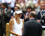 Prince Edward, Duke of Kent presents Maria Sharapova of Russia her second place thropy after losing her Ladies' final round match against  Petra Kvitova of the Czech Republic on Day Twelve of the Wimbledon Lawn Tennis Championships at the All England Lawn Tennis and Croquet Club on July 2, 2011 in London, England.  Kvitova won 6-3 6-4.
