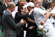 Prince Edward, Duke of Kent and Billie Jean King congratulate Mike Bryan of the United States after winning his final round Gentlemen's Doubles match against Horia Tecau of Romania and Robert Lindstedt of Sweden on Day Twelve of the Wimbledon Lawn Tennis Championships at the All England Lawn Tennis and Croquet Club on July 2, 2011 in London, England.