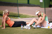 Sabine Lisicki of Germany talks with Barbara Rittner, captain of the German Fed Cup team during a practice session on day eleven of the Wimbledon Lawn Tennis Championships at the All England Lawn Tennis and Croquet Club on July 5, 2013 in London, England.