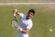 Novak Djokovic of Serbia leaps to smash the ball during the Gentlemen's Singles semi-final match against Juan Martin Del Potro of Argentina on day eleven of the Wimbledon Lawn Tennis Championships at the All England Lawn Tennis and Croquet Club on July 5, 2013 in London, England.