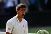 Novak Djokovic of Serbia celebrates match point during the Gentlemen's Singles semi-final match against Juan Martin Del Potro of Argentina on day eleven of the Wimbledon Lawn Tennis Championships at the All England Lawn Tennis and Croquet Club on July 5, 2013 in London, England.