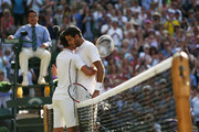 Novak Djokovic of Serbia embraces Juan Martin Del Potro of Argentina at the net after their Gentlemen's Singles semi-final match on day eleven of the Wimbledon Lawn Tennis Championships at the All England Lawn Tennis and Croquet Club on July 5, 2013 in London, England.