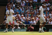 Juan Martin Del Potro of Argentina and Novak Djokovic of Serbia smile after having a discussion during the Gentlemen's Singles semi-final match on day eleven of the Wimbledon Lawn Tennis Championships at the All England Lawn Tennis and Croquet Club on July 5, 2013 in London, England.