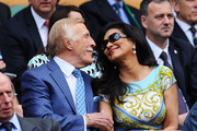 Sir Bruce Forsyth and his wife Wilnelia attend the Ladies' Singles second round match between Eugenie Bouchard of Canada and Ana Ivanovic of Serbia on day three of the Wimbledon Lawn Tennis Championships at the All England Lawn Tennis and Croquet Club on June 26, 2013 in London, England.