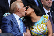 Sir Bruce Forsyth kisses his wife Wilnelia during the Ladies' Singles second round match between Eugenie Bouchard of Canada and Ana Ivanovic of Serbia on day three of the Wimbledon Lawn Tennis Championships at the All England Lawn Tennis and Croquet Club on June 26, 2013 in London, England.