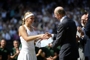 Sabine Lisicki of Germany receives her runner-up trophy from Prince Edward, Duke of Kent on Centre Court after her Ladies' Singles final match against Marion Bartoli of France on day twelve of the Wimbledon Lawn Tennis Championships at the All England Lawn Tennis and Croquet Club on July 6, 2013 in London, England.