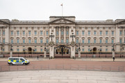 A police van cruises in the empty area in front of Buckingham Palace on the day that Queen Elizabeth II is set to move to Windsor Palace in a bid to avoid the COVID-19 coronavirus pandemic on March 18, 2020 in London, England.