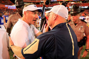 Head coach Dan Mullen (L) of the Florida Gators shakes hands with head coach Mark Tucker of the Charleston Southern Buccaneers following the game at Ben Hill Griffin Stadium on September 1, 2018 in Gainesville, Florida.