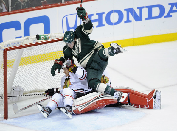 Charlie Coyle Charlie Coyle #63 of the Minnesota Wild lands on top of ...