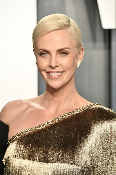 2020 Vanity Fair Oscar Party Hosted By Radhika Jones - Arrivals [hair,blond,hairstyle,face,shoulder,eyebrow,beauty,skin,lip,chin,radhika jones - arrivals,radhika jones,charlize theron,beverly hills,california,wallis annenberg center for the performing arts,oscar party,vanity fair,charlize theron,wallis annenberg center for the performing arts,celebrity,vanity fair,oscar party,bombshell,92nd academy awards,actor,photography,party]