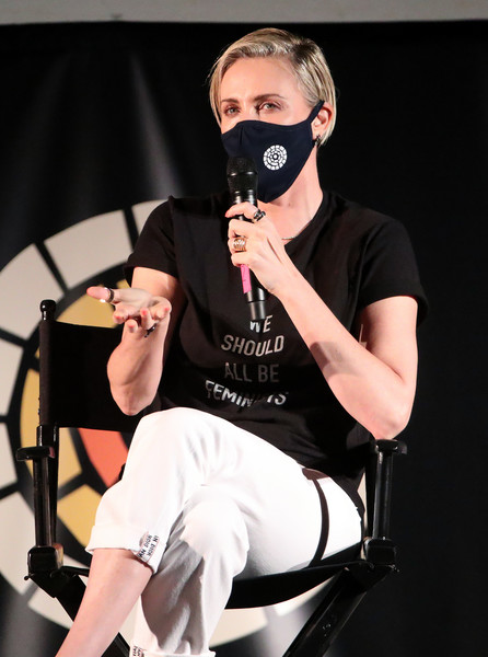"Charlize Theron Hosts Drive-In Screening Of ""Mad Max: Fury Road"" Benefiting The Charlize Theron Africa Outreach Project [mad max: fury road,product,arm,shoulder,headgear,personal protective equipment,photography,neck,performance,t-shirt,costume,t-shirt,sunglasses,charlize theron hosts drive-in screening,charlize theron,charlize theron africa outreach project,product,arm,shoulder,headgear,sunglasses,t-shirt]"