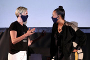 """(L-R) Charlize Theron and Aisha Tyler speak onstage at Charlize Theron Hosts Drive-In Screening of """"Mad Max: Fury Road"""" Benefiting the Charlize Theron Africa Outreach Project at The Grove on July 31, 2020 in Los Angeles, California."""