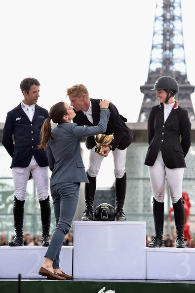 Charlotte Casiraghi Charlotte Casiraghi congratulates the Winners of the 'Gucci Gold Cup Paris Eiffel Jumping Table A against the clock with jump-off ' (L-R) Maikel van der Vleuten (2nd rank), Marcus Ehning (1st rank) and Reed Kessler (3rd rank) aknowledge the applause of the audience during the Paris Eiffel Jumping presented by Gucci at Champ-de-Mars on July 6, 2014 in Paris, France.