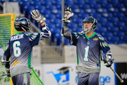 Joe Walters #1 and Ben Rubeor #6 of the Chesapeake Bayhawks.celebrate a first half goal against the Charlotte Hounds at Navy-Marine Corps Memorial Stadium on August 9, 2014 in Annapolis, Maryland.