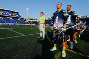 Head coach Dave Cottle and Joe Walters #1 of the Chesapeake Bayhawks listen to the national anthem before the start of their game against the Charlotte Hounds at Navy-Marine Corps Memorial Stadium on July 25, 2015 in Annapolis, Maryland.
