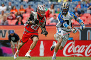 Drew Snider #23 of Denver Outlaws controls the ball against Kevin Drew #19 of Charlotte Hounds at Sports Authority Field at Mile High on May 3, 2015 in Denver, Colorado. The Outlaws defeated the Hounds 15-12.