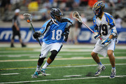 Kyle Harrison #18 of the Ohio Machine controls the ball against Kevin Drew #19 of the Charotte Hounds in the second quarter at Selby Stadium on May 16, 2015 in Delaware, Ohio. Ohio defeated Charlotte 14-10.
