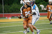 Jordan MacIntosh #29 of the Rochester Rattlers carries the ball against Kevin Drew #19 of the Charlotte Hounds at Eunice Kennedy Shriver Stadium on July 17, 2015 in Brockport, New York. Rochester defeated Charlotte 18-10.
