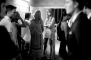 Image has been converted to black and white) Model Nicole Pollard waits backstage before the 'Chase the Sun' Fashion Showcase at Indooroopilly Shopping Centre on September 3, 2015 in Brisbane, Australia.