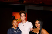 (L-R) Angela Simmons, Milo Manheim and Ashanti attend as Cheetos unveiled fan-inspired versions of the #CheetosFlaminHaute look at The House Of Flamin' Haute Runway Show + Style Bar Experience during Fashion Week on September 05, 2019 in New York City.
