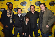 "(L-R) Musician Gary Clark, Jr, actor John Leguizamo, actor Emjay Anthony, director Jon Favreau and actor Oliver Platt pose for photos in the Green Room for the premiere of ""Chef"" during the 2014 SXSW Music, Film + Interactive Festival at the Paramount Theatre on March 7, 2014 in Austin, Texas."