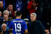 Jose Mourinho manager of Chelsea shakes hands with Diego Costa of Chelsea during the UEFA Champions League Group G match between Chelsea FC and FC Porto at Stamford Bridge on December 9, 2015 in London, United Kingdom.