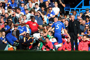 Jose Mourinho manager of Manchester United watches Paul Pogba of Manchester United challenge Jorginho of Chelsea during the Premier League match between Chelsea FC and Manchester United at Stamford Bridge on October 20, 2018 in London, United Kingdom.