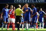 Mike Dean and Diego Costa Photos Photo
