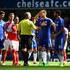 Mike Dean Diego Costa Photos - Referee Mike Dean talks with Diego Costa of Chelsea during the Barclays Premier League match between Chelsea and Arsenal at Stamford Bridge on September 19, 2015 in London, United Kingdom. - Chelsea v Arsenal - Premier League