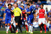 Chelsea players surround referee Mike Dean during the Barclays Premier League match between Chelsea and Arsenal at Stamford Bridge on September 19, 2015 in London, United Kingdom.