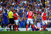 Santi Cazorla of Arsenal is shown a red card by referee Mike Dean during the Barclays Premier League match between Chelsea and Arsenal at Stamford Bridge on September 19, 2015 in London, United Kingdom.