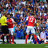 Santi Cazorla Mike Dean Photos - Santi Cazorla of Arsenal is shown a red card by referee Mike Dean during the Barclays Premier League match between Chelsea and Arsenal at Stamford Bridge on September 19, 2015 in London, United Kingdom. - Chelsea v Arsenal - Premier League