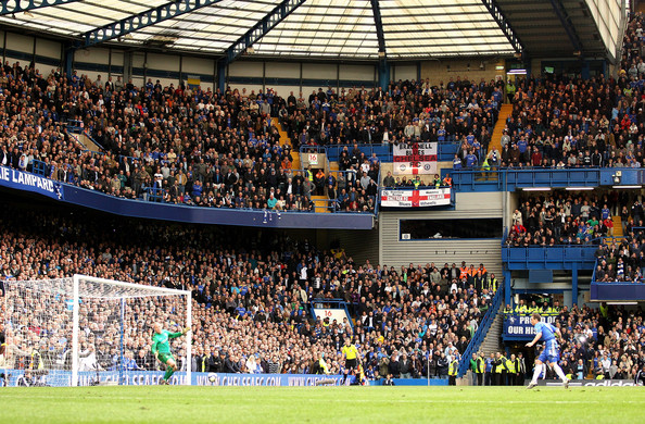 A general view as Frank Lampard of Chelsea shoots to score his third goal, a penalty during the Barclays Premier League match between Chelsea and Aston Villa at Stamford Bridge on March 27, 2010 in London, England.