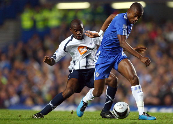 Salomon Kalou of Chelsea battles for the ball with Fabrice Muamba of Bolton Wanderers during the Carling Cup 4th Round match between Chelsea and Bolton Wanderers at Stamford Bridge on October 28, 2009 in London, England.