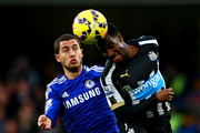 Vurnon Anita of Newcastle United battles for the ball with Eden Hazard of Chelsea during the Barclays Premier League match between Chelsea and Newcastle United at Stamford Bridge on January 10, 2015 in London, England.