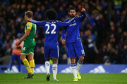 Diego Costa (R) of Chelsea celebrates scoring his team's first goal with his team mate Willian (L) during the Barclays Premier League match between Chelsea and Norwich City at Stamford Bridge on November 21, 2015 in London, England.