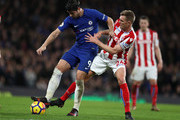 Alvaro Morata of Chelsea and Darren Fletcher of Stoke City during the Premier League match between Chelsea and Stoke City at Stamford Bridge on December 30, 2017 in London, England.