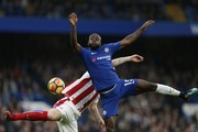Chelsea's Nigerian midfielder Victor Moses (R) vies with Stoke City's Scottish midfielder Charlie Adam during the English Premier League football match between Chelsea and Stoke City at Stamford Bridge in London on December 30, 2017. / AFP PHOTO / Ian KINGTON / RESTRICTED TO EDITORIAL USE. No use with unauthorized audio, video, data, fixture lists, club/league logos or 'live' services. Online in-match use limited to 75 images, no video emulation. No use in betting, games or single club/league/player publications.  /