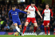 Eden Hazard of Chelsea is challenged by Gareth Barry of West Bromwich Albion during the Premier League match between Chelsea and West Bromwich Albion at Stamford Bridge on February 12, 2018 in London, England.