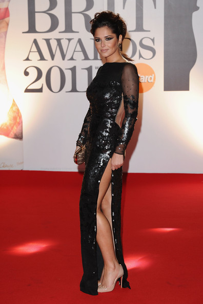 Cheryl Cole Singer Cheryl Cole arrives on the red carpet for The BRIT Awards 2011 at the O2 Arena on February 15, 2011 in London, England.
