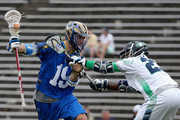 Kevin Drew #19 of the Charlotte Hounds is hit by Jovan Miller #23 of the Chesapeake Bayhawks during their game at American Legion Memorial Stadium on May 10, 2015 in Charlotte, North Carolina.